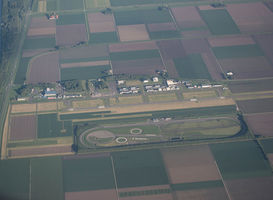 Normal_lelystad_airport__via_wiki___an_aerial_picture_of_lelystad_airport_and_aviodrome_taken_from_estonian_airways_flight_ov_0473__